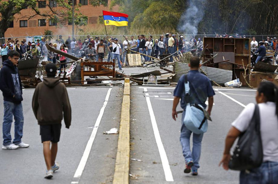 Supporters of opposition leader Leopoldo Lopez stand at a barricade during a protest against Nicolas Maduro's government in a middle-class neighborhood in Caracas February 20, 2014.
