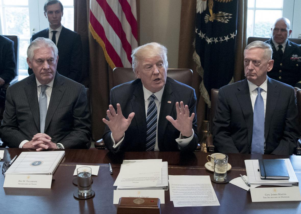 94926340President Donald Trump holds a meeting with members of his cabinet including Secretary of State Rex Tillerson (L) and Secretary of Defense James Mattis