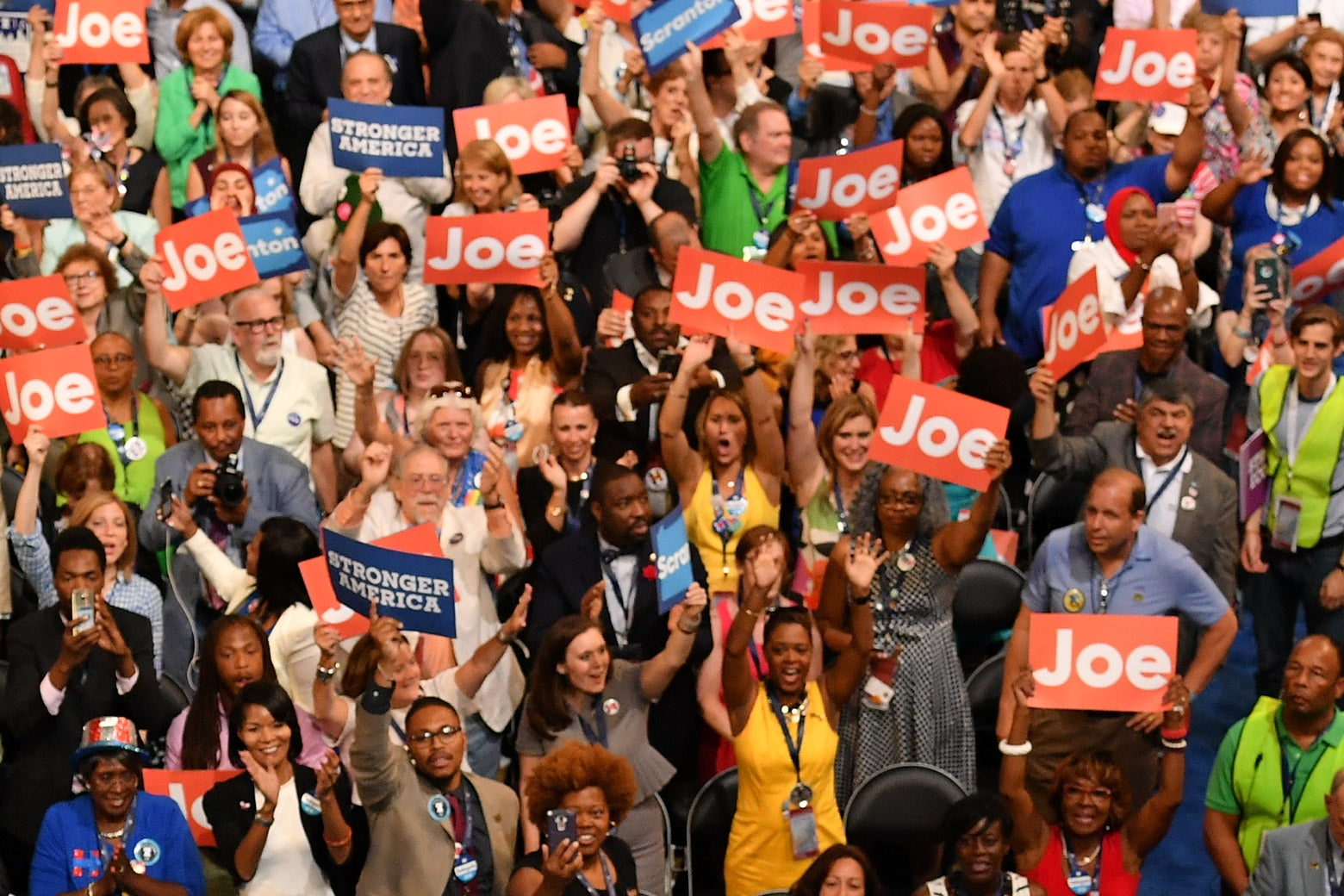 """A crowd cheers and holds up """"Joe"""" and """"STRONGER TOGETHER"""" signs."""