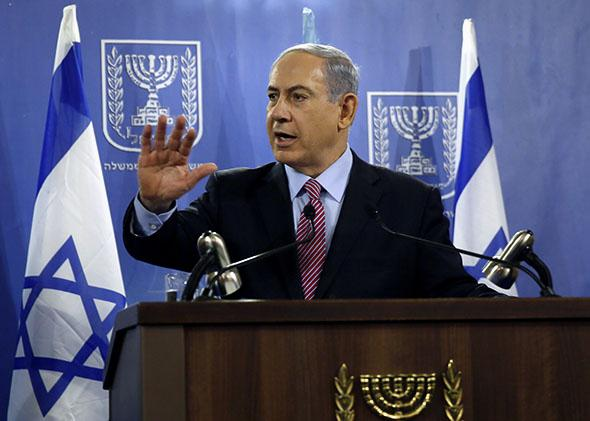 Israeli Prime Minister Benjamin Netanyahu speaks to the press at the Defense Ministry in Tel Aviv on July 22, 2014.