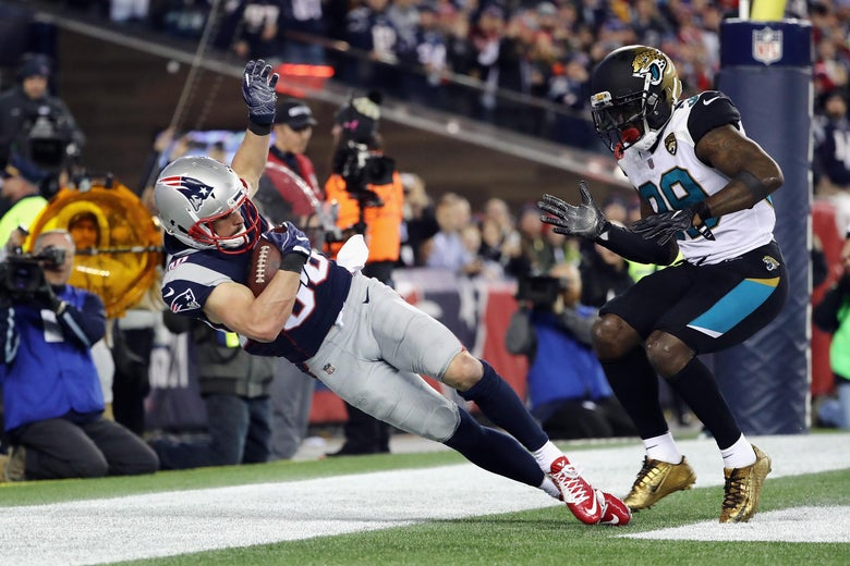 FOXBOROUGH, MA - JANUARY 21:  Danny Amendola #80 of the New England Patriots catches a touchdown pass as he is defended by Tashaun Gipson #39 of the Jacksonville Jaguars in the fourth quarter during the AFC Championship Game at Gillette Stadium on January 21, 2018 in Foxborough, Massachusetts.  (Photo by Elsa/Getty Images)