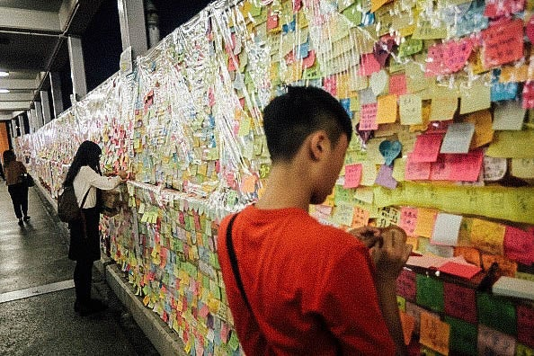Residents view the protest-themed Post-It Notes.