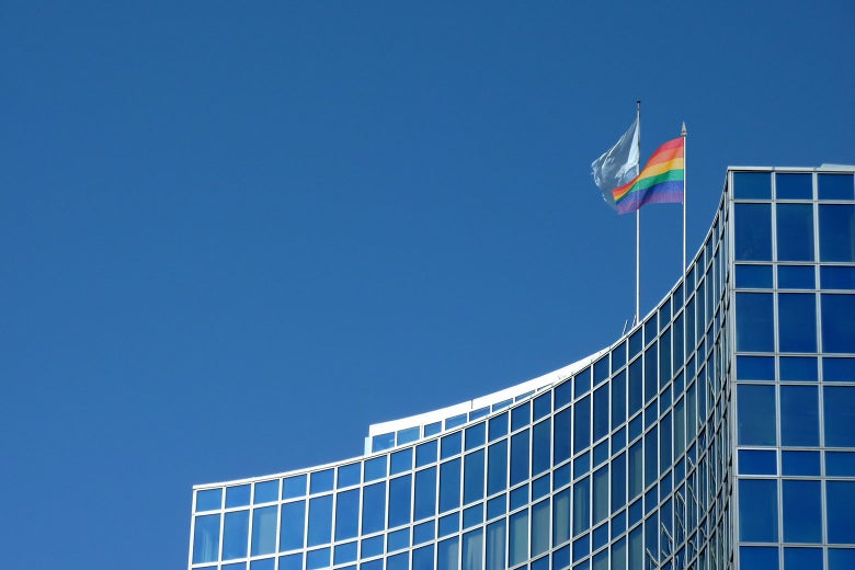 The U.N. headquarters with a pride flag flying atop it.