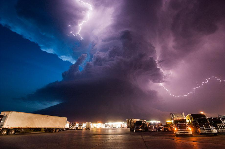 A supercell storm during twilight nears a York, Neb., truck stop on I80 as it spits out lightning, June 17, 2009.