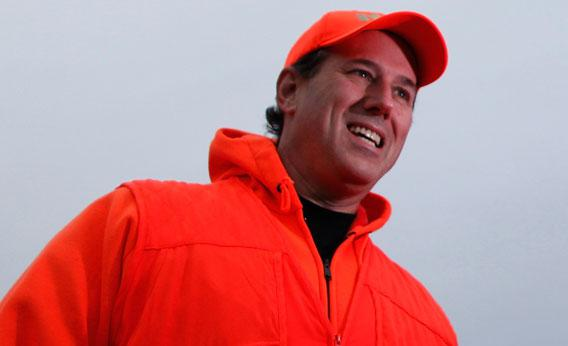 GOP presidential candidate and former U.S. Senator Rick Santorum (R-PA) talks to reporters in Adel, Iowa.