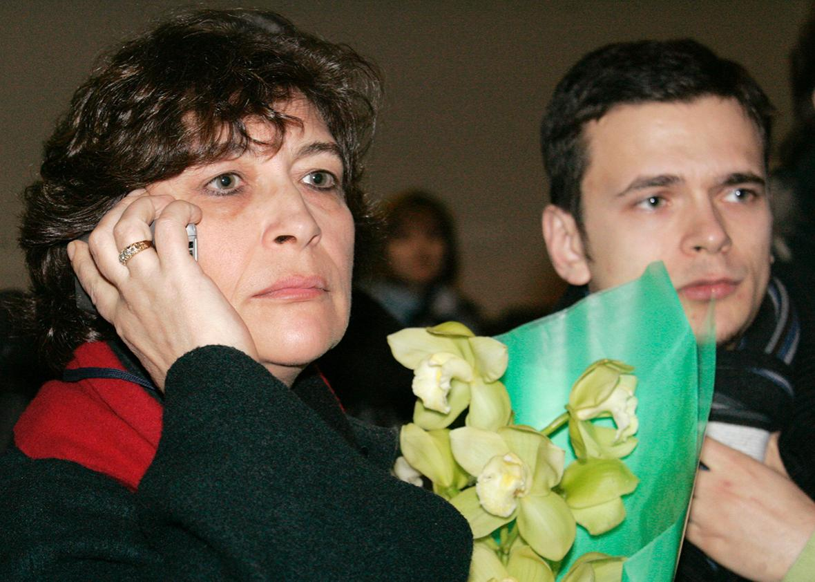 Yevgenia Albats, deputy to the editor-in-chief of The New Times magazine and Ilya Yashin, leader of Yabloko party's youth wing, wait at a Moscow airport for an investigative journalist, Natalya Morari, who is being refused entry to Russia, February 27, 2008.