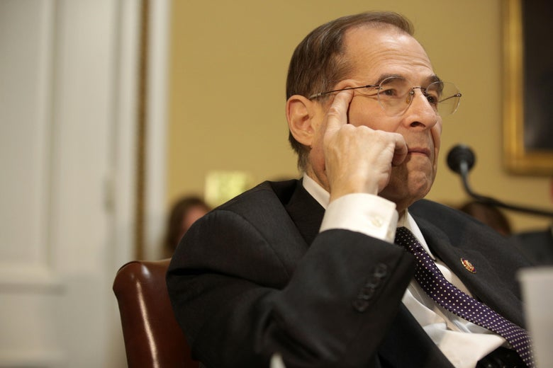 Rep. Jerrold Nadler presses his hand to his face as he listens at a meeting at the U.S. Capitol.