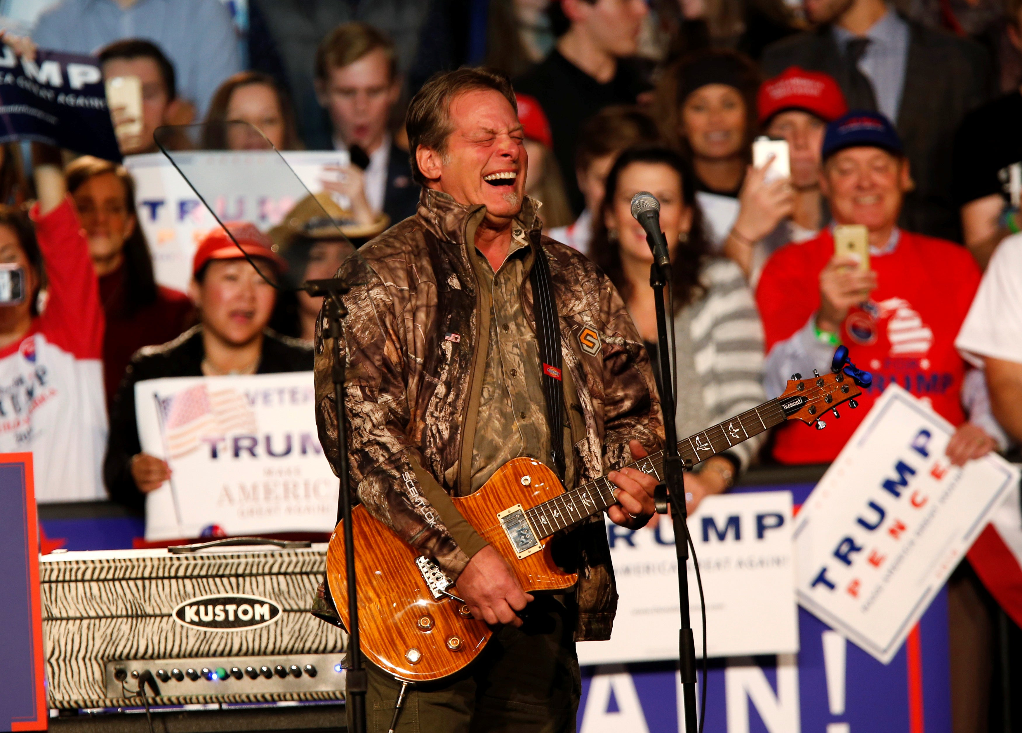 Musician and political activist Ted Nugent performs for the audience during a campaign rally for Donald Trump at the Devos Place in Grand Rapids, Michigan November 7, 2016.