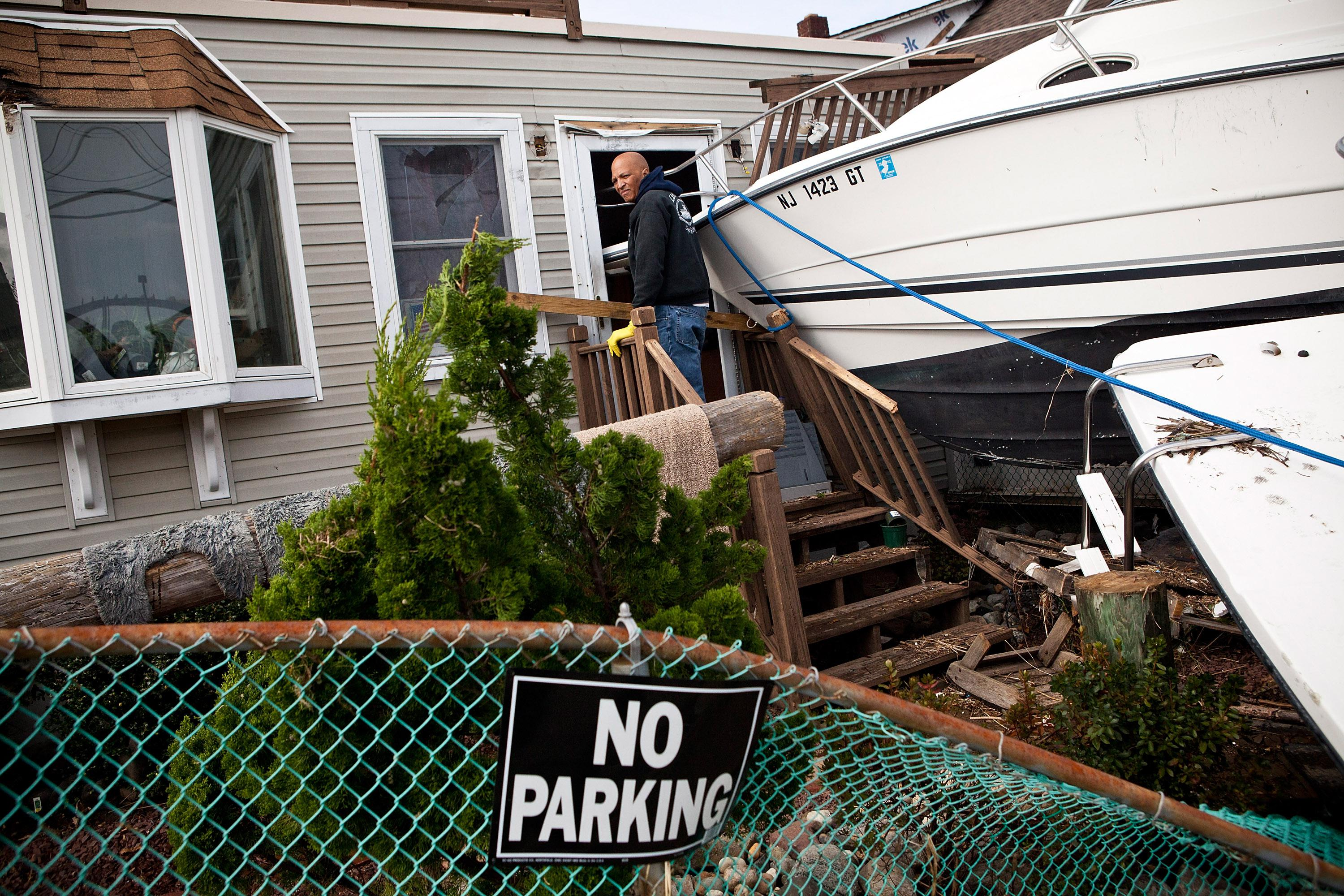 Clifford Seay helps his girlfriend, Regina Yahara-Splain, clean out her home, which was damaged by Superstorm Sandy, on November 1, 2012 in Highlands, New Jersey.