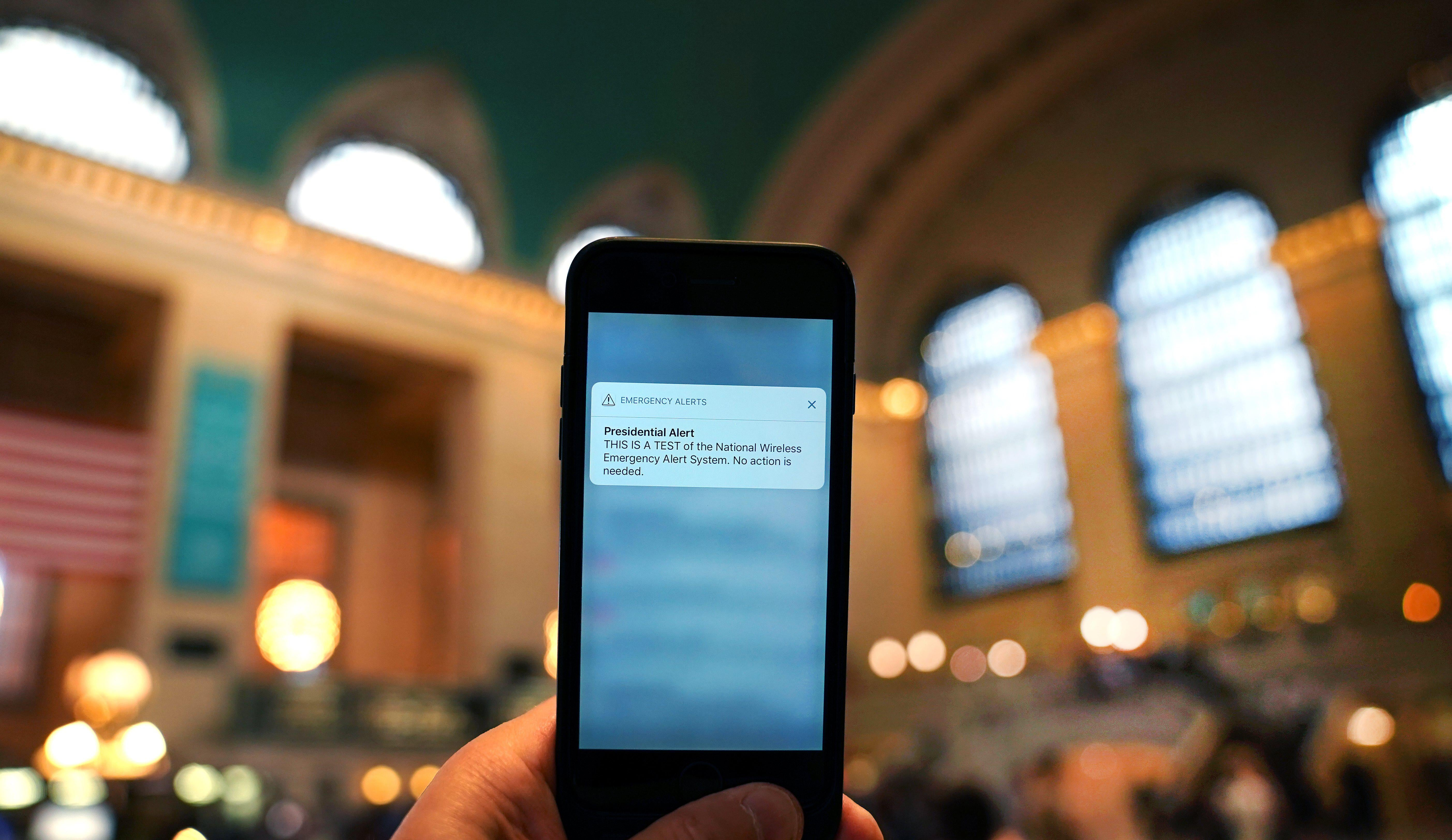 A phone is seen in Grand Central Station as it receives an emergency test presidential-alert message.