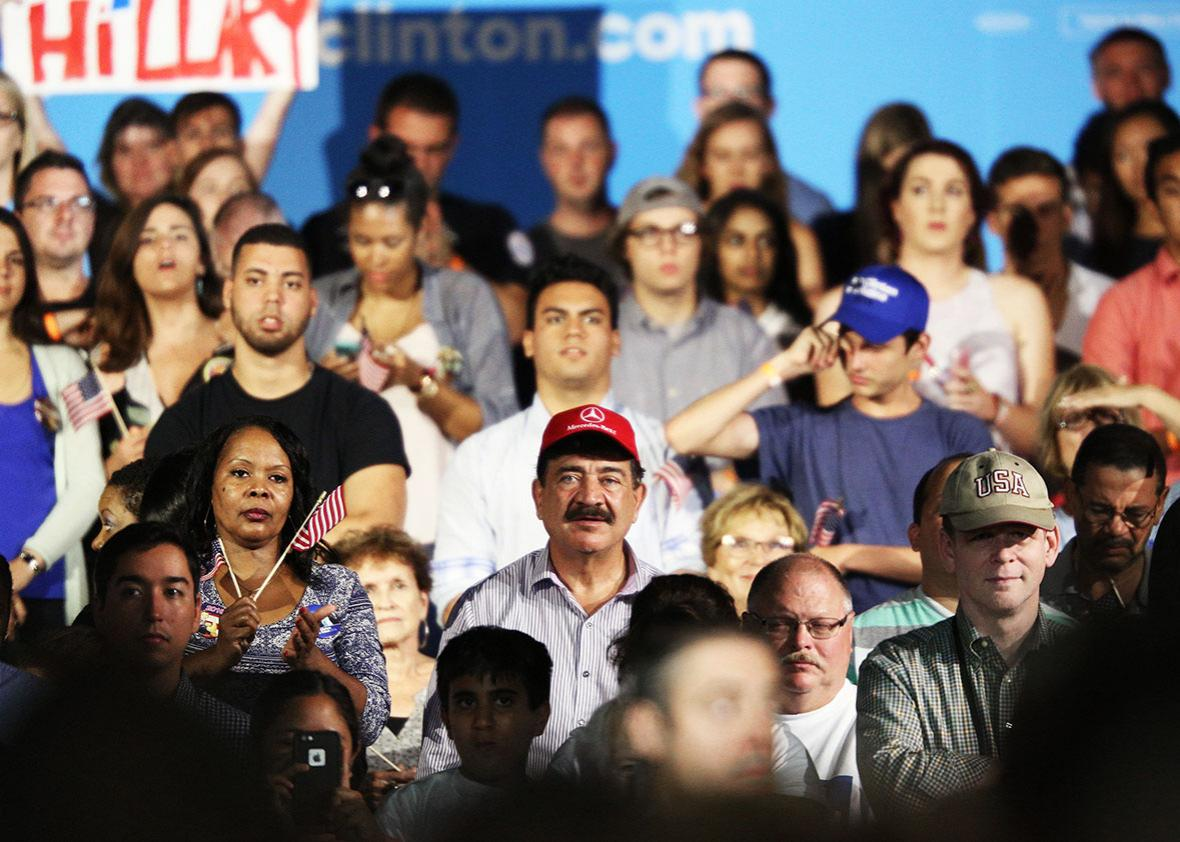 A man identified as Seddique Mateen, whose son shot and killed 49 people and injured 53 others inside the Pulse nightclub in June, sits with supporters at a rally for Democratic Presidential nominee Hillary Clinton at the Osceola Heritage Park in Kissimmee, Florida on August 8, 2016.