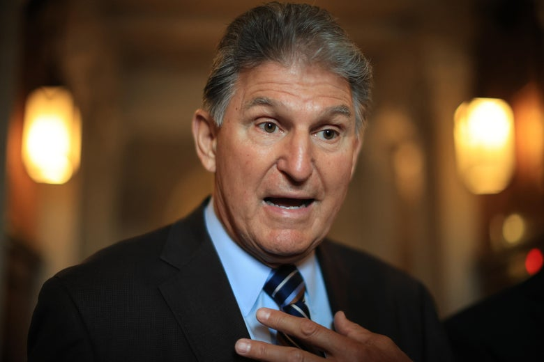 Sen. Joe Manchin (D-WV) talks with reporters after stepping off the Senate Floor at the U.S. Capitol on May 28, 2021 in Washington, D.C.