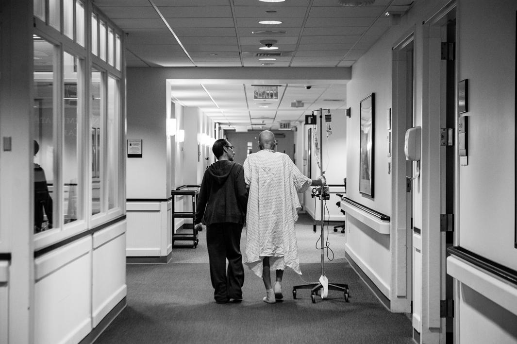 Recovering from a collapsed lung and managing a recent pneumonia diagnosis, Howard Borowick takes a walk down the hallways of Medical Oncology with the assistance of wife, Laurel Borowick, left, by his side. Greenwich, Connecticut. November, 2013.