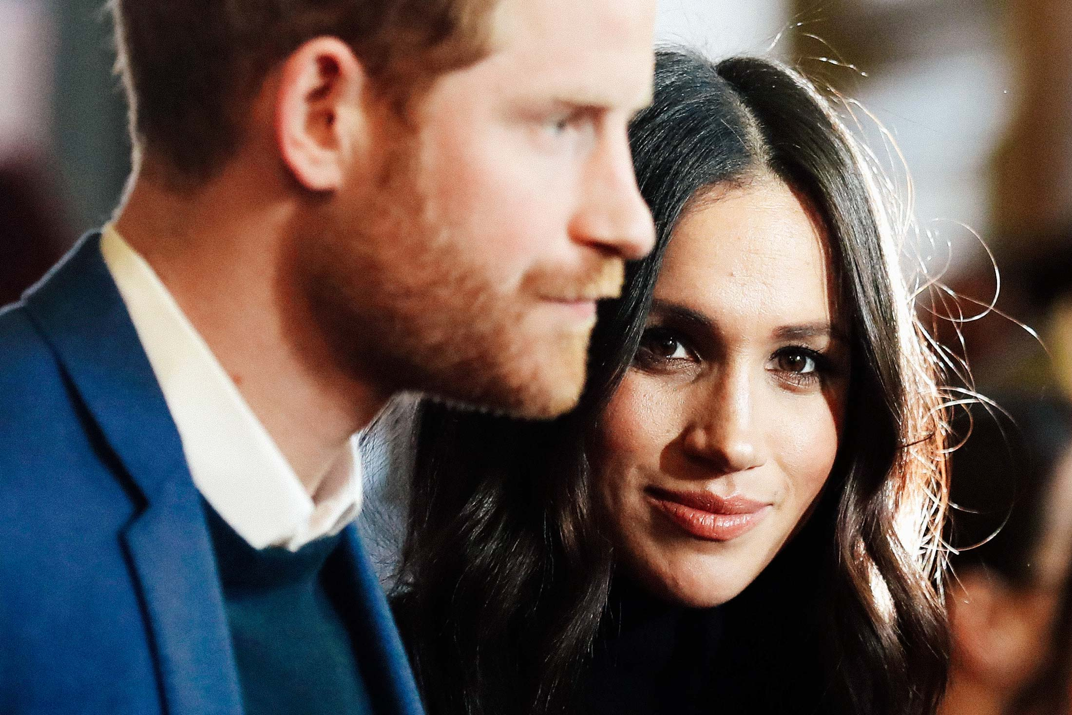 Prince Harry and Meghan Markle attend a reception at the Palace of Holyroodhouse in Edinburgh on Feb. 13.