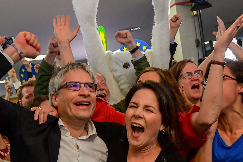 German Greens party top candidate Sven Giegold and party leader Annalena Baerbock celebrate.
