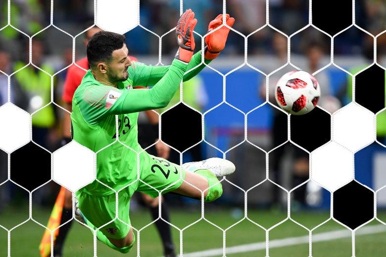 Danijel Subasic of Croatia saves a penalty kick during the match between Croatia and Denmark in Nizhny Novgorod, Russia on Sunday.