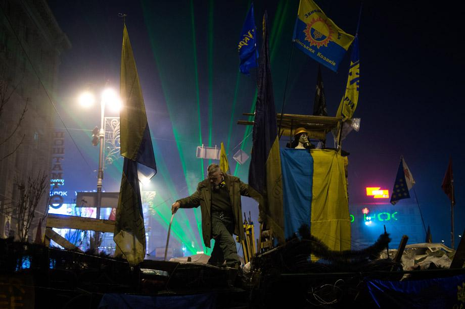 A protester stands on a barricade in Kiev on Feb. 15, 2014.
