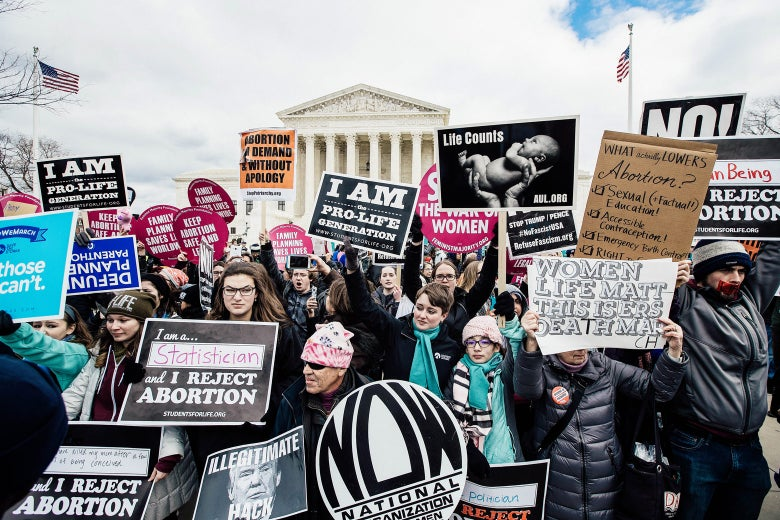 A mix of anti-abortion advocates and pro-choice advocates rally outside of the Supreme Court during the March for Life.