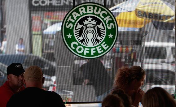 People sit inside a Starbucks Coffee shop in lower Manhattan August 21, 2009 in New York City.