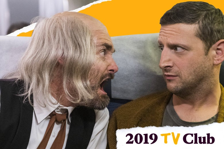 Will Forte cries like a baby in Tim Robinson's face as they both sit on a plane in this still from I Think You Should Leave.