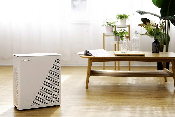 Air purifier in a room with plants