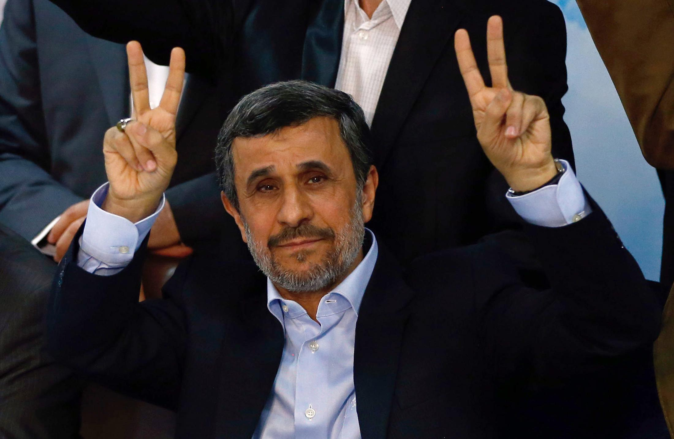 Former Iranian president Mahmoud Ahmadinejad (C) flashes the sign for victory at the Interior Ministry's election headquarters as candidates begin to sign up for the upcoming presidential elections in Tehran on April 12, 2017.Ahmadinejad had previously said he would not stand after being advised not to by supreme leader Ayatollah Ali Khamenei, saying he would instead support his former deputy Hamid Baghaie who also registered on Wednesday.
