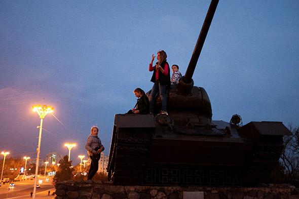 Children play on a tank, a monument to Transnistria's 1992 war of secession with Moldova in which over 1000 people were killed.