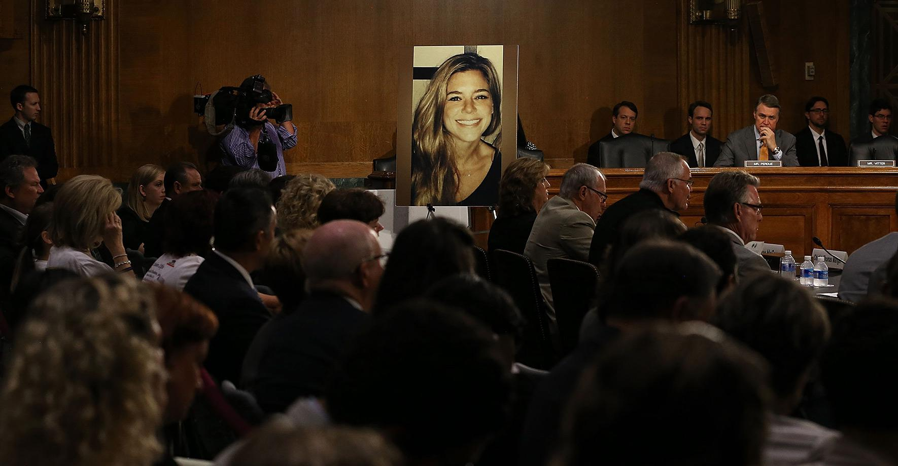 """A large photo of Kathryn """"Kate"""" Steinle, who was killed by an illegal immigrant in San Francisco, is shown while her dad, Jim Steinle, testifies during a Senate Judiciary Committee hearing on Capitol Hill on July 21, 2015."""