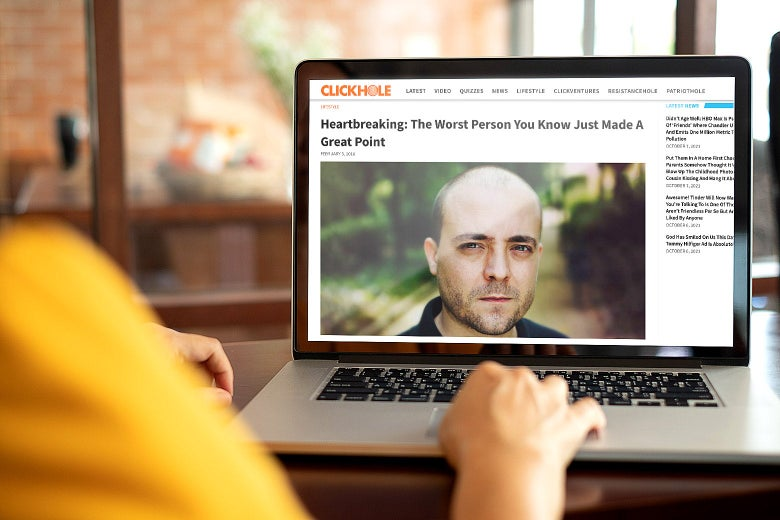 """Person looking at laptop screen showing the top of the ClickHole post headlined """"Heartbreaking: The Worst Person You Know Just Made a Great Point"""""""