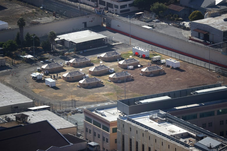 An aerial view of San Quentin prison, with tents set up in the yard.