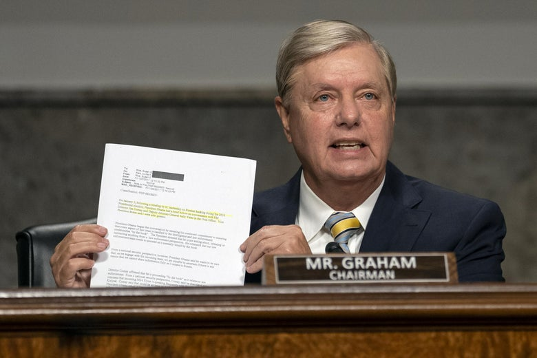Lindsey Graham holds up a memo at a hearing.