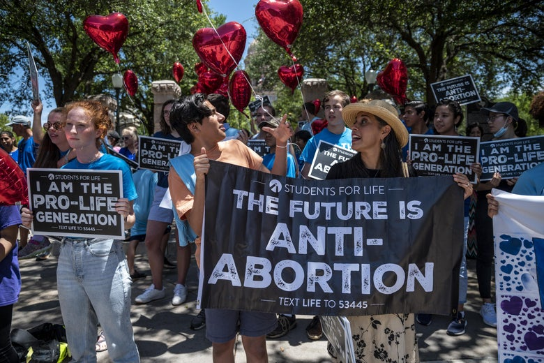 """Protesters hold signs that read, """"The future is anti-abortion."""""""