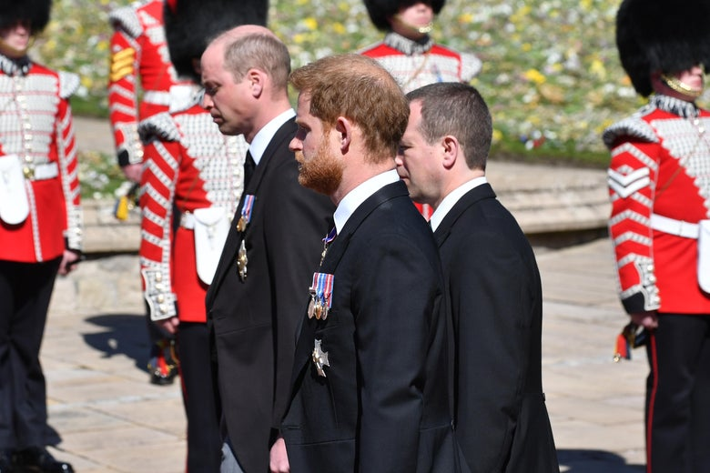 Prince William, Duke of Cambridge; Prince Harry, Duke of Sussex and Peter Phillips walk behind Prince Philip, Duke of Edinburgh's coffin in a procession during the funeral of Prince Philip, Duke of Edinburgh at Windsor Castle on April 17, 2021 in Windsor, United Kingdom.