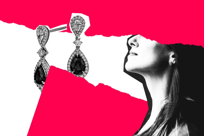 Expensive-looking earrings next to a woman's neck.