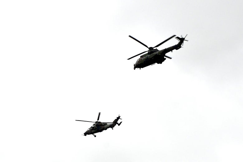 French Army helicopters fly past during a ceremony of seven French soldiers of the 5th RHC (Fighter Helicopter Regiment) died in a helicopter collision in Mali, in Pau-Uzein on December 03 2019, southwestern France. - The soldiers died when two helicopters collided last Monday while pursuing jihadists in northern Mali, where militant violence has soared in recent months. (Photo by Iroz Gaizka / AFP) (Photo by IROZ GAIZKA/AFP via Getty Images)