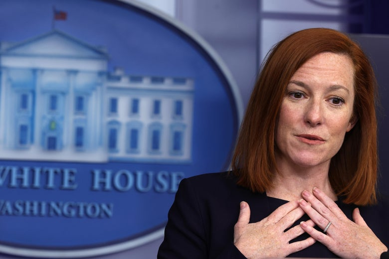 Jen Psaki touches her hands to her collarbone during a press briefing.