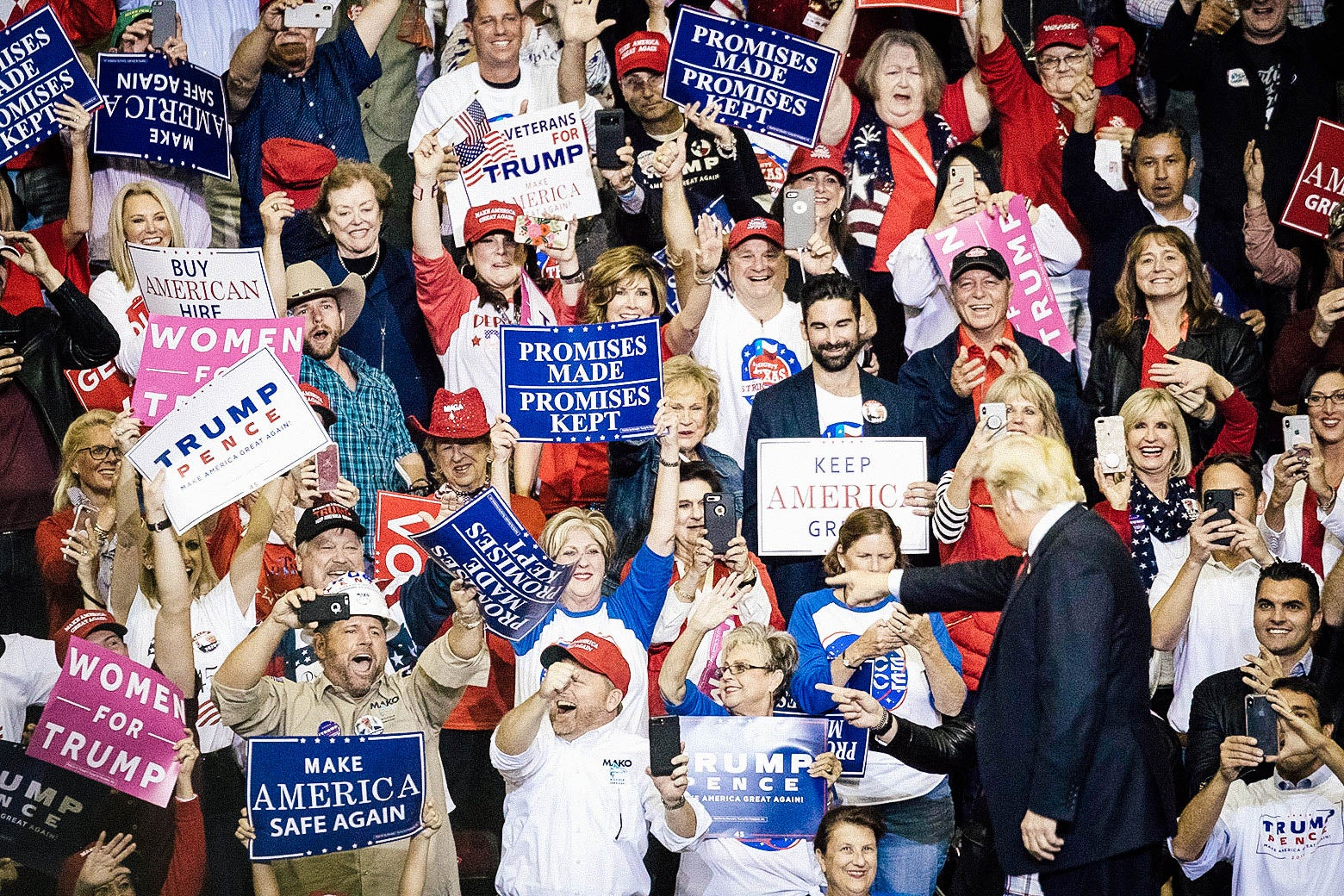 Supporters cheer as President Donald Trump takes the stage for a rally in support of Sen. Ted Cruz.