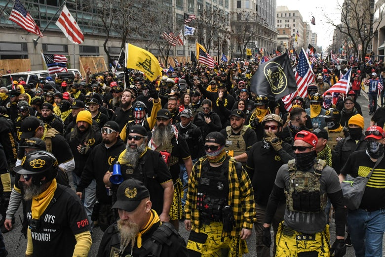 Members of the Proud Boys march towards Freedom Plaza during a protest on December 12, 2020 in Washington, D.C.