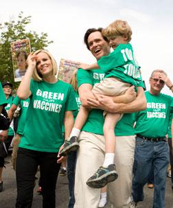 Actor Jim Carrey holds Evan McCarthy, son of actress Jenny McCarthy. Click image to expand.