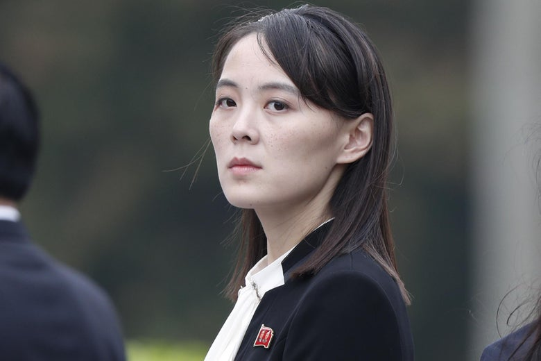 Kim Yo-jong looks back over her shoulder at the camera.