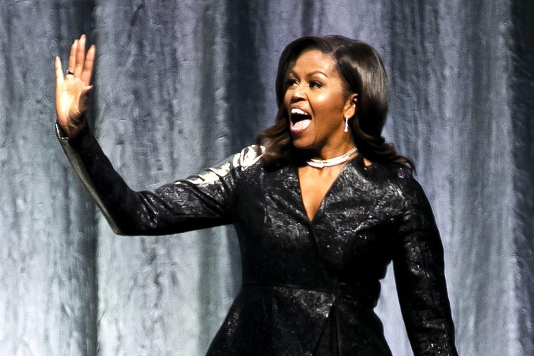 Former First Lady Michelle Obama gestures as he stands on stage to speak at the Ziggo Dome in Amsterdam on April 17, 2019.