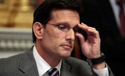 House Majority Leader Rep. Eric Cantor talks with reporters in his office at the U.S. Capital. Click image to expand.