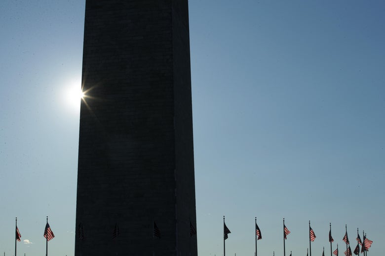 U.S. flags fly near of the Washington Monument on Flag Day