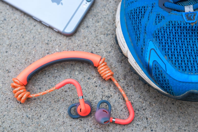 Urbanears headphones next to a shoe.