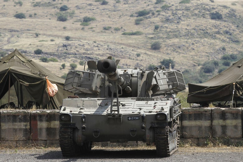 An Israeli artillery unit takes position near the Syrian border in the Israeli-annexed Golan Heights on May 9, 2018.