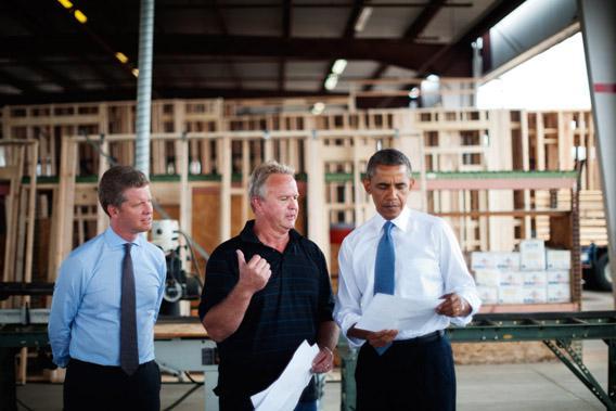 President Obama and Housing Secretary Shaun Donovan (L) tour Erickson Construction on August 6, 2013 in Chandler, Arizona.