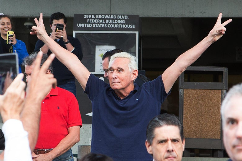 Roger Stone throws up peace signs outside court January 25, 2019 in Fort Lauderdale, Florida.