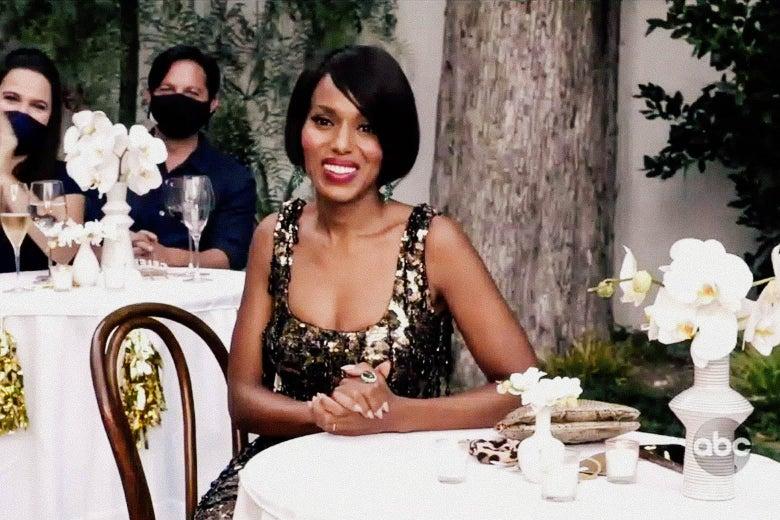 Kerry Washington sits at a table.