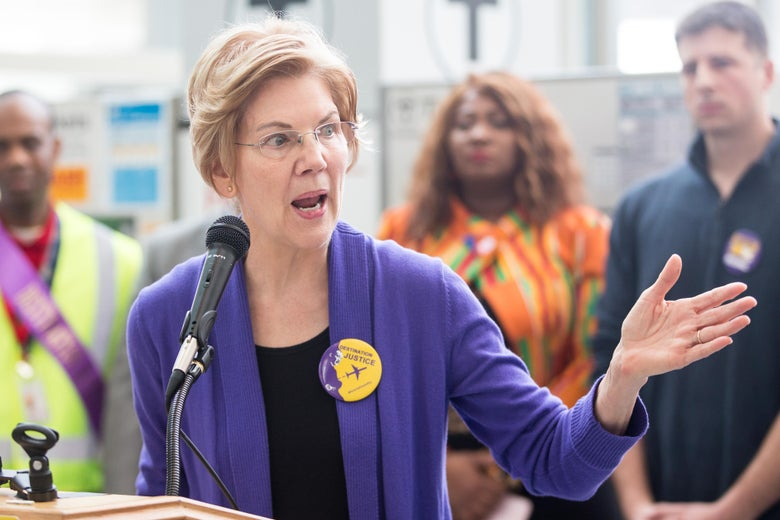 Elizabeth Warren speaks at a rally for airport workers at the Boston airport.