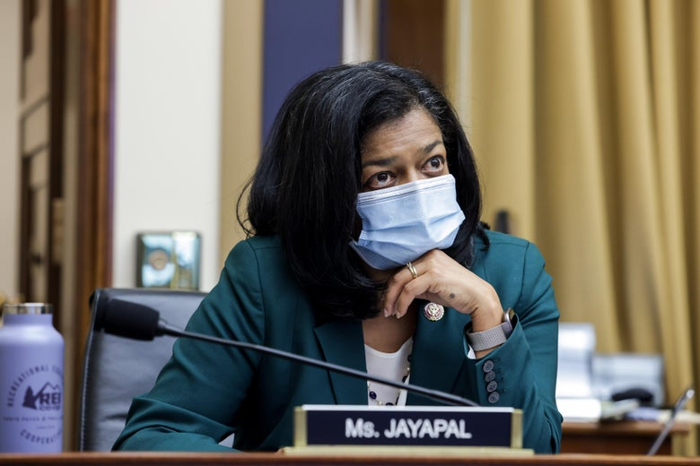 Jayapal wears a mask as she sits in a hearing room.